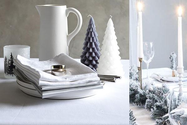 Une nappe de Noël damassé en blanc uni, des serviettes de couleur argent.